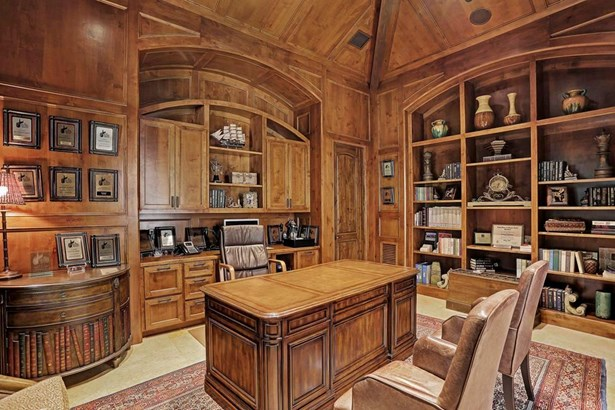 Masculine paneled study with Knotty Alder custom cabinets and built-in bookshelves, vaulted ceiling and Jerusalem limestone floors. (photo 3)