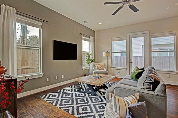 Perspective of living area in the model home located in the community of Hollister Park.First floor living located just off the entry grants easy entertaining and excellent flow. Back door opens to private backyard and covered patio. Home is prewired for (photo 5)
