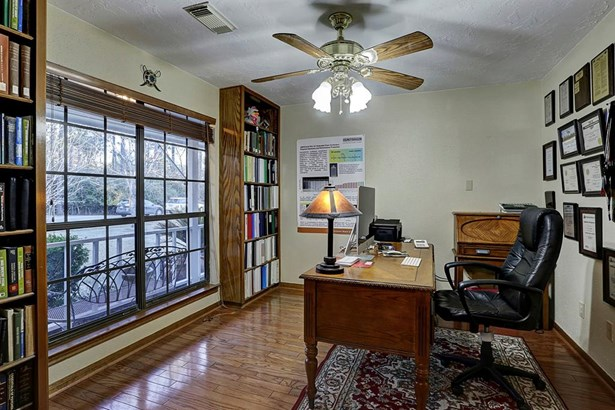 Spacious office room contains plenty of natural lighting and a great view of the front yard. (photo 5)