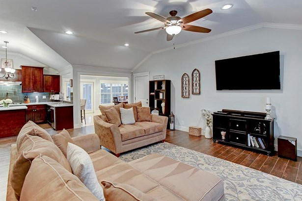 Stepping through the front door you are welcomed into the large living room with 10 ft ceilings. A coat closet off the entry adds extra storage to keep items neatly tucked away. Wood look tile runs from the living room into the kitchen. (photo 3)