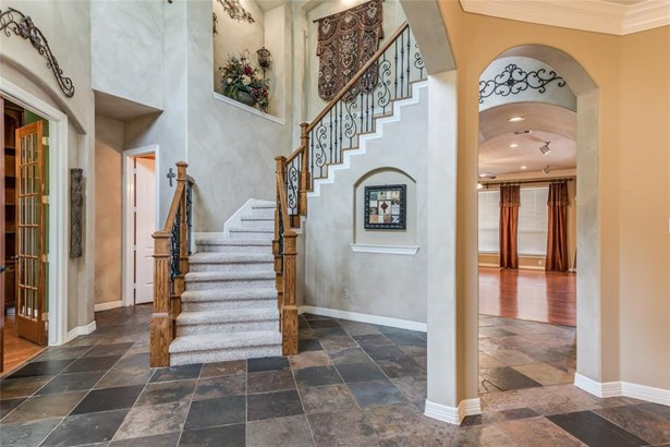 The 2-story slate front entry has lost of architectural interest with the iron and wood stair railing, art niches, arched doorways and an enormous amount of natural light. (photo 4)