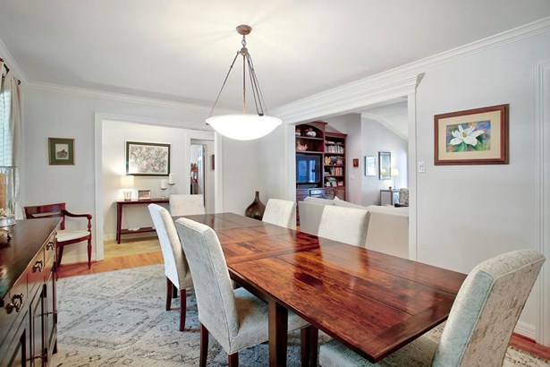 The Dining Room sits off the Entry Hall and is open to the Great Room as well as the Living Room. (photo 4)