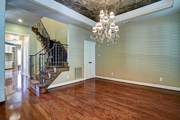Close up view of the dining room looking to the living area. Wrought iron winding staircase. (photo 4)
