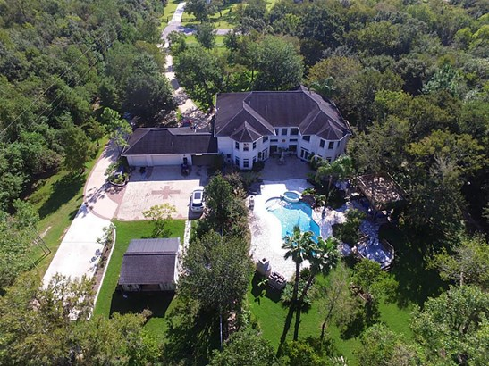 Wow! This estate home offers so much! Set on 4.35 wooded acres, there s space galore to watch the deer frolic and children play! (photo 1)