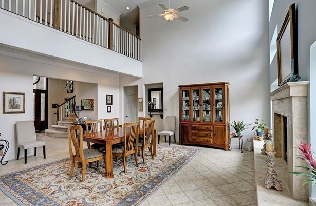 Currently being used as a very large dining room, this living room makes a statement. (photo 5)