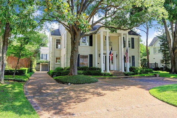 The grand trees flanking both sides of the home provide beautiful curb appeal. The circular driveway and automatic gate to the garage and garden apartment are just some of the features that make this home exceptional. (photo 2)