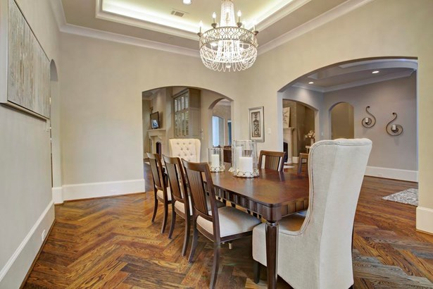 """To the left of the front entry sits the lovely formal dining room. Note the herringbone pattern in the 7"""" oak wood floor planks. (photo 4)"""