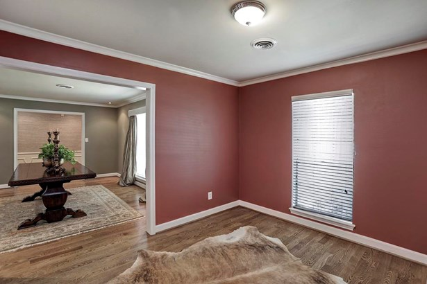This is the view from the original dining room looking through the original formal living into the entry foyer w/ wainscot paneling. Double-wide doorways throughout these area promotes great flow for entertaining. (photo 3)