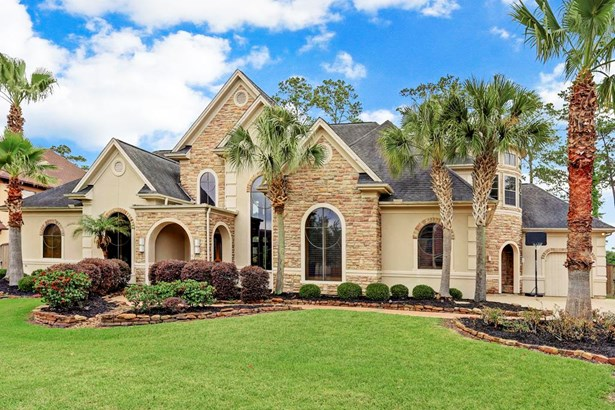 The 5,406 SF (per builder) home with stucco & stacked stones sits on a 17,295 SF lot in the premium section at the back of The Forest. The community entrance is conveniently located just minutes from I-45. (photo 1)