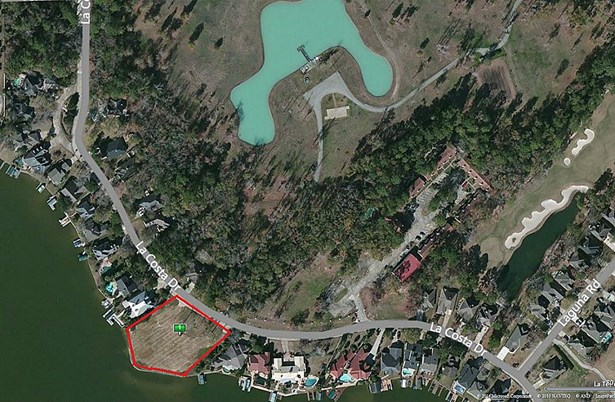 This RED LINE tract is of the approximately 1 ACRE LOT facing Lake Conroe. (photo 1)