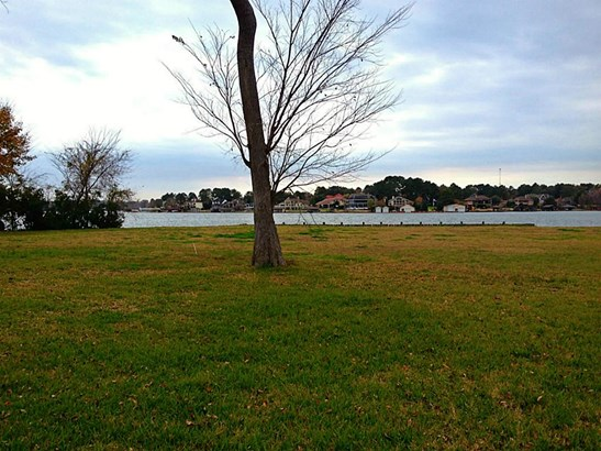 This is a view of the LOT that fronts on LAKE CONROE. This site is bulkheaded, level, and ready for construction. (photo 2)