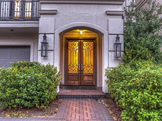 Great curb appeal and landscaped front entrance with brick walkway and lanterns leading to double wood & iron front doors provides a warm welcome to this extraordinary home. (photo 2)