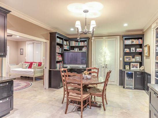 This very versatile executive study is open from the entry and leads to a downstairs bedroom suite -- great for a guest suite or adjoining flex room. The double doors open to a small outdoor patio & green space. (photo 4)