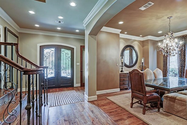 The custom iron and glass door sets the tone for this impressive home. The wide entry provides access to all first floor living areas: study, dining room, den, kitchen breakfast area and mud room. A portion of the entry ceiling is double groin vaulted wit (photo 2)