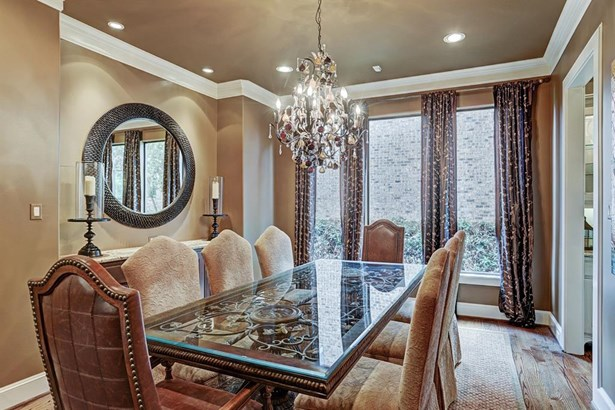 The magnificent chandelier and custom draperies will remain with the home. The room is flooded with natural light and can accommodate a large dining table. (photo 3)