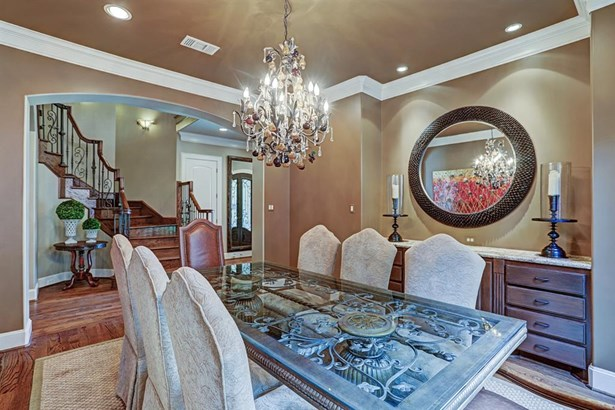 The built- in buffet has storage below and a limestone serving surface. It is not only beautiful but functional. The room offers recessed lighting and art lighting as well. (photo 4)