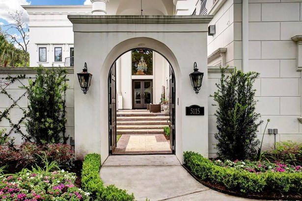 Walk through the gate and enter a private inner-sanctum of this one of a kind home. (photo 2)