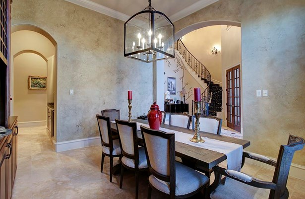 Formal dining opens to the entry way and is connected to the kitchen area via butlers pantry. Lantern style fixture compliments the style carried throughout. (photo 5)