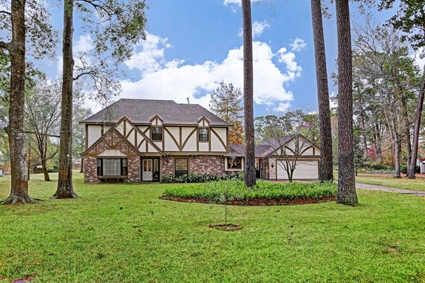 Lovely Tudor style traditional home set on lush, wooded, 1.127 acre lot in Forest Cove. Beautifully maintained with many updates, this inviting home is ready for new owners and new memories. Easy access to 59 yet still a very private and quite location (photo 1)