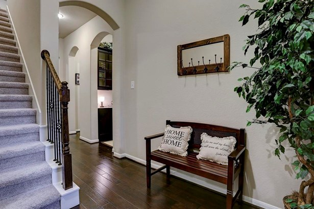 Upon entry guests are welcomed by lovely wood floors and a neutral carpeted stairway leading to the upstairs. (photo 2)