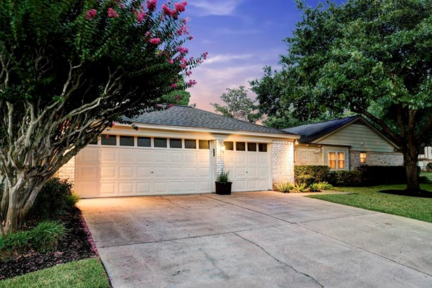 Attached 3-car garage with outside lights and sensors. The entire house is secured with security cameras and DVR. (photo 5)