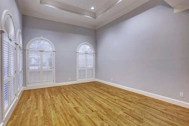 The formal living room features gorgeous views of the front yard, hardwood floors, crown molding and tall ceilings. (photo 3)