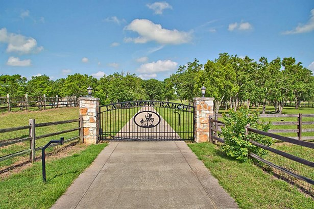 Welcome to LA MANCHA RANCH!This exceptional property is located on over 10 acres of land and is a horse lovers dream. The property is conveniently located close to shopping, hospitals, schools and a short distance to Hwy 290/HWY 99. (photo 1)