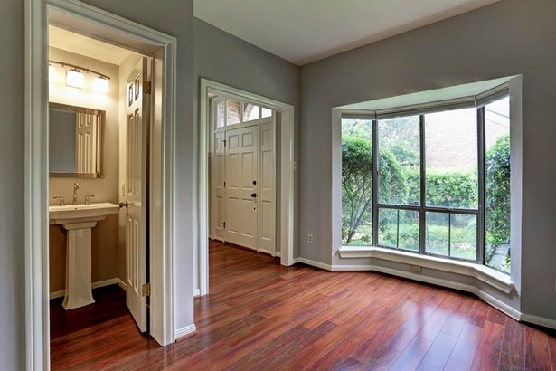 As you enter, on your left a study or you decide what you d like to utilize this room as. This room has as half bath and windows allow for natural light and views of the lush landscaping (photo 3)