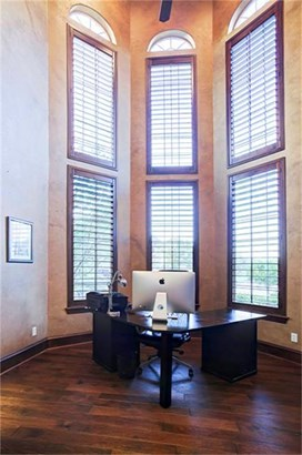 Grand two-story study/home office is positioned to the right just upon entry. Wood stained trim accents the large picture windows. (photo 4)