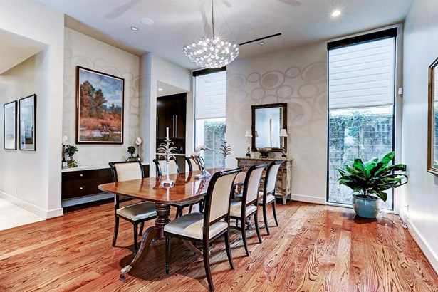 Beautiful dining room with custom chandelier, built-in sideboard with storage...great light and lots of room for entertaining..the butlers pantry is to the left with kitchen access (photo 4)