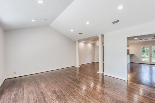 Updated vaulted ceiling and recessed lighting create a light and bright formal living room. Beaming refinished hardwoods give a most refreshing and new feel throughout the home. (photo 4)