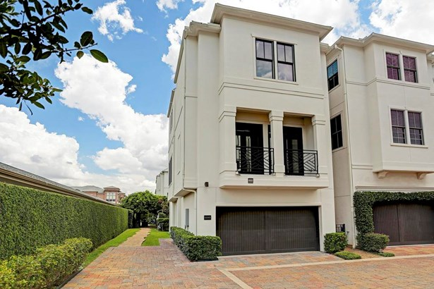 Welcome to this 3 bedroom, 3 1/2 bath freestanding home in a gated community. This traditional home has a white stucco exterior and includes a balcony and back patio space. (photo 2)