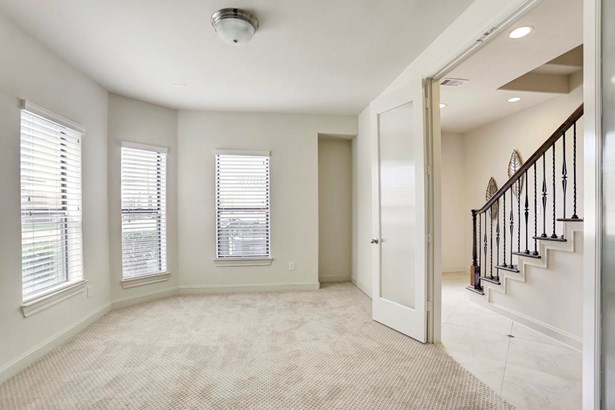 First floor bedroom has new plush carpet (6/2017), incredible natural light, and French style doors with glass. (photo 4)