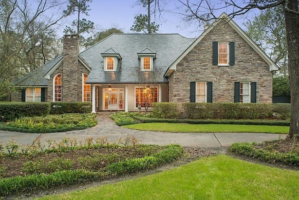 Warm, spacious 5/6 bedroom home situated in desirable Hunters Creek Village surrounded by a stunning park-like setting on nearly an acre lot! Traditional, brick and North Carolina bluestone home with front circle drive. (photo 1)
