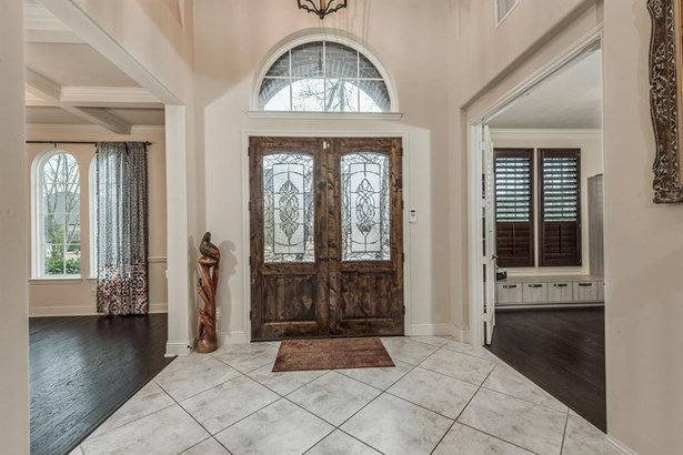 2-story entry with beautiful wood & leaded glass double front doors open to the formal dining room on the left and formal study on the right. (photo 2)