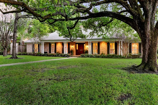 Beautiful trees welcome you to this inviting traditional home. (photo 1)