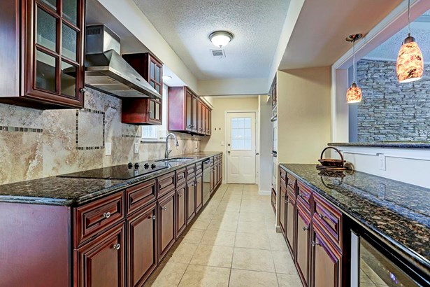 New appliances throughout the kitchen. Door leads to garage. (photo 5)