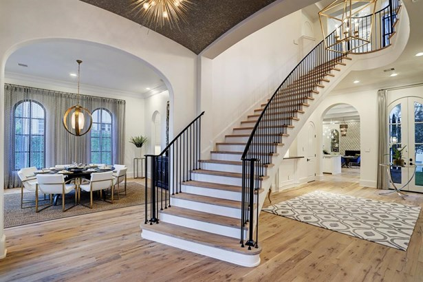 Grand and spacious foyer features designer lighting, custom wallpapered groin ceiling and sweeping staircase with Antique European White Oak hardwood floors throughout the first and second floors! (photo 2)