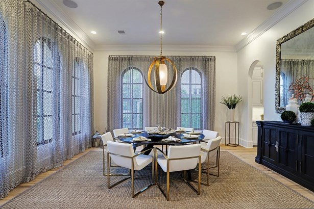 Formal dining room with 12 ft ceilings, arched 9 ft windows with custom draperies, sound system speakers and spectacular designer lighting! Gracious arched doorway leads to the stunning butler's pantry. (photo 3)