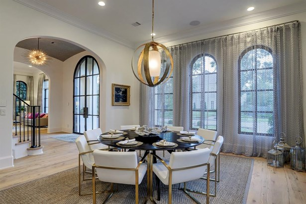 Spacious and light-filled formal dining room, entry foyer and formal living room with views of the tree-lined streets and homes of beautiful River Oaks (photo 4)