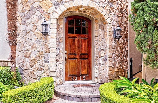 The home s attractive exterior is stuccoand stone. It is neatly landscaped, and brick pavers lead to the front door. Let s go inside and take a look! (photo 2)