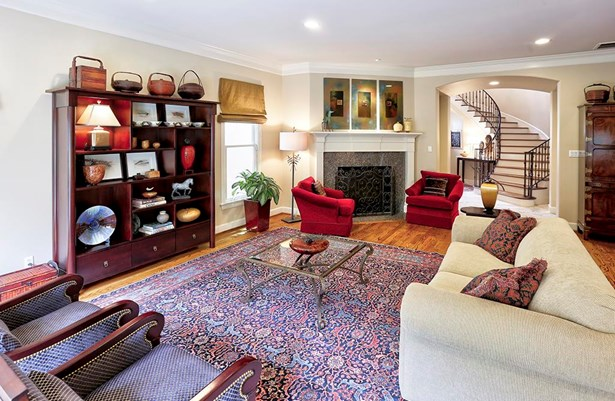 The living room measures 25 long! its gas log fireplace with stone surround ignites with the flip of a switch. Over the fireplace there is upgraded dedicated lighting for your favorite work of art. (photo 5)