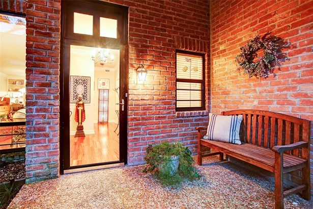Homes feature brick facades and community is lined with lush greenery and landscaping. (photo 2)