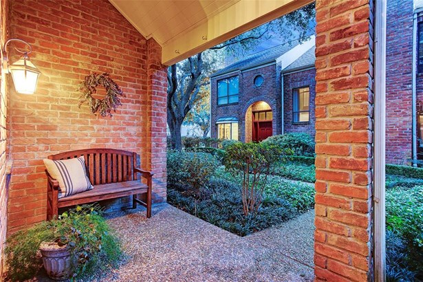 Home features its own private front porch which provides lots of charm. (photo 3)