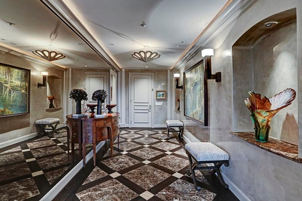 Entry with marble floors and oak inserts with mirrored wall. (photo 2)