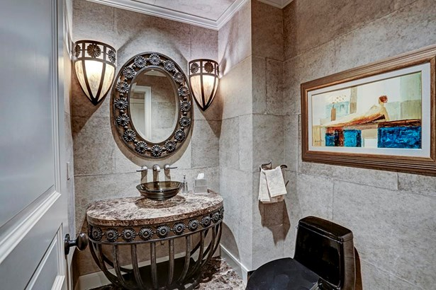 Powder Bath with custom furniture style iron vanity, marble counter top and vessel sink. (photo 3)