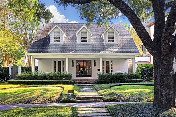 The front yard of this magnificent residence is graced by a beautiful oak tree. The front path is made of cement stepping stones. There is a sizeable front porch which harkens back to earlier days. (photo 1)