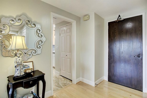 Entrance accented with hardwood flooring. (photo 2)