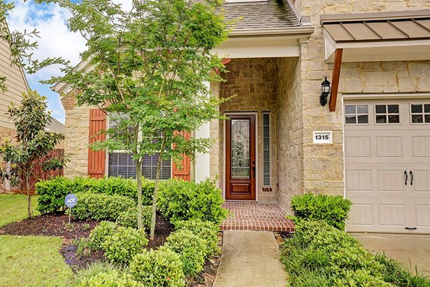 One is immediately welcomed by the lush landscaping; lovely stone & brick elevation; custom bricked porch area; and beautiful leaded glass insert mahogany front door. (photo 2)
