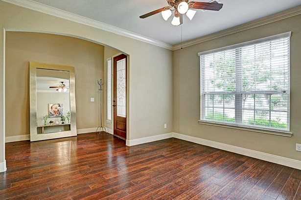 One enters into this lovely foyer area with crown moldings above and warm, rich, hardwood flooring below. Immediately upon entering is this multi- purpose space which could be an excellent study or also a formal living room. (photo 3)
